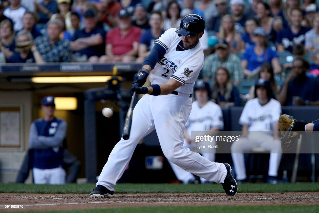 Travis Shaw #21 of the Milwaukee Brewers hits a grand slam in the seventh inning against the Los Angeles Dodgers at Miller Park on June 3, 2017 in Milwaukee, Wisconsin.