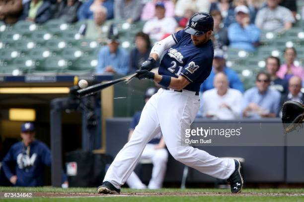 Travis Shaw of the Milwaukee Brewers hits a single in the first inning against the Cincinnati Reds at Miller Park on April 26 2017 in Milwaukee...