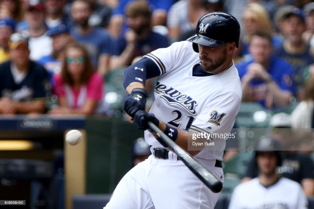 Travis Shaw #21 of the Milwaukee Brewers hits a single in the fourth inning against the Miami Marlins at Miller Park on September 17, 2017 in Milwaukee, Wisconsin.