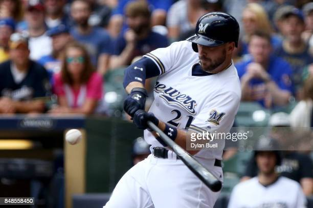 Travis Shaw of the Milwaukee Brewers hits a single in the fourth inning against the Miami Marlins at Miller Park on September 17 2017 in Milwaukee...