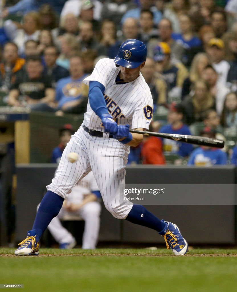 Travis Shaw #21 of the Milwaukee Brewers hits a single in the sixth inning against the Miami Marlins at Miller Park on April 20, 2018 in Milwaukee, Wisconsin.