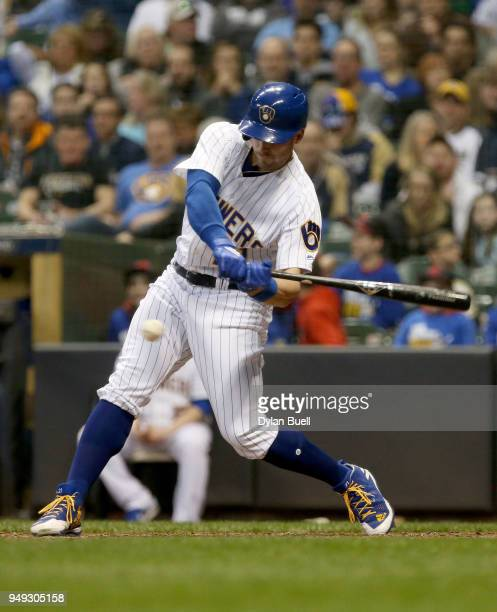 Travis Shaw of the Milwaukee Brewers hits a single in the sixth inning against the Miami Marlins at Miller Park on April 20 2018 in Milwaukee...