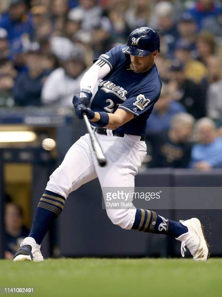 Travis Shaw of the Milwaukee Brewers hits a single in the third inning against the Chicago Cubs at Miller Park on April 07, 2019 in Milwaukee,...