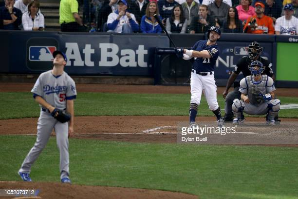 Travis Shaw of the Milwaukee Brewers hits a solo home run against Alex Wood of the Los Angeles Dodgers during the sixth inning in Game Two of the...