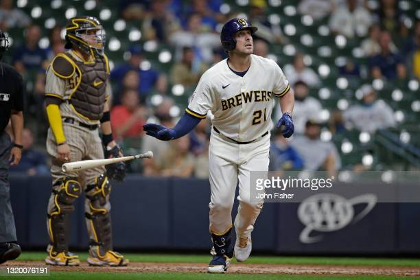 Travis Shaw of the Milwaukee Brewers hits a solo home run to right field in the seventh inning against the San Diego Padres at American Family Field...