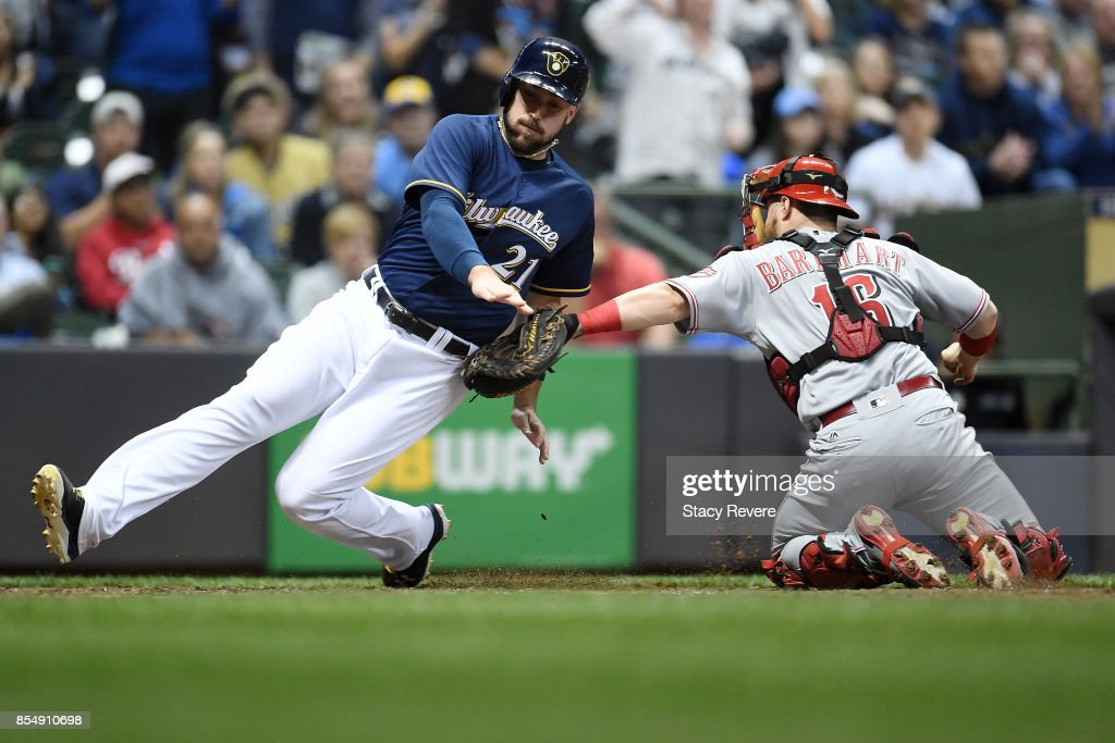 Travis Shaw #21 of the Milwaukee Brewers is tagged out at home plate by Tucker Barnhart #16 of the Cincinnati Reds during the fourth inning of a game at Miller Park on September 27, 2017 in Milwaukee, Wisconsin.