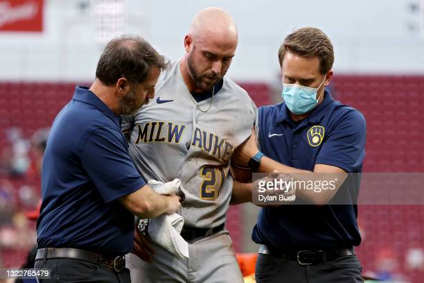 Travis Shaw of the Milwaukee Brewers leaves the game after being injured in the second inning against the Cincinnati Reds at Great American Ball Park...