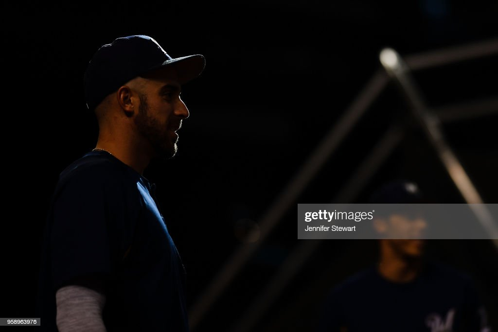 Travis Shaw #21 of the Milwaukee Brewers looks on during batting practice prior to the MLB game against the Arizona Diamondbacks at Chase Field on May 15, 2018 in Phoenix, Arizona.
