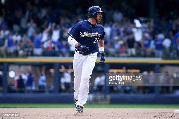 Travis Shaw of the Milwaukee Brewers rounds the bases after hitting a walk off home run to beat the Chicago Cubs 43 in ten innings at Miller Park on...
