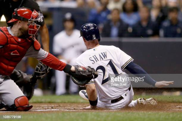 Scott Schebler of the Cincinnati Reds hits a single in the first inning against the Milwaukee Brewers at Miller Park on September 18 2018 in...