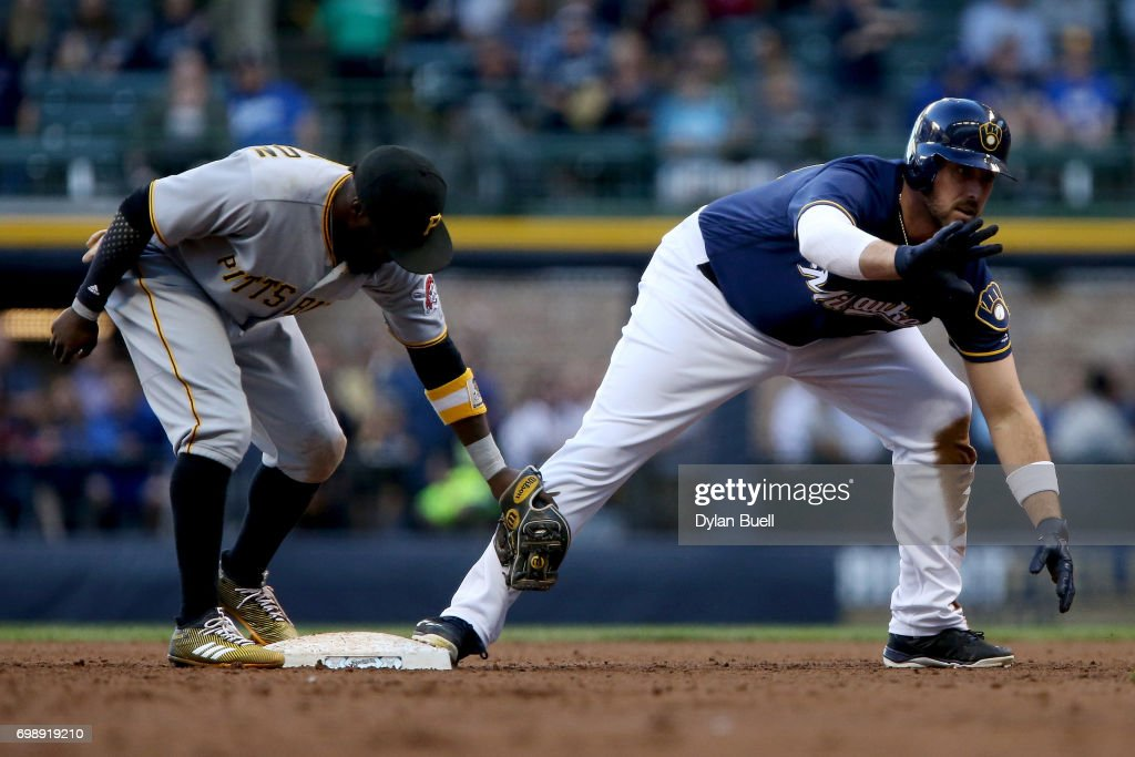 Travis Shaw #21 of the Milwaukee Brewers slides into second base for a double past Josh Harrison #5 of the Pittsburgh Pirates in the third inning at Miller Park on June 20, 2017 in Milwaukee, Wisconsin.