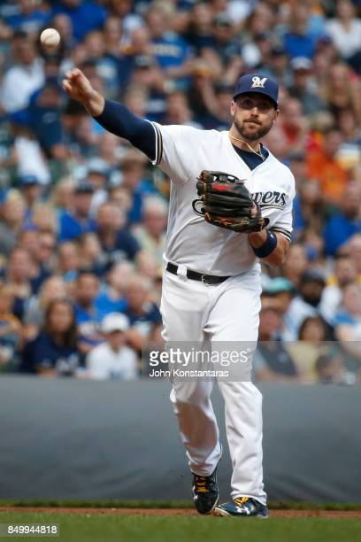 Travis Shaw of the Milwaukee Brewers throws out Adam Conley of the Miami Marlins during the first inning at Miller Park on September 16 2017 in...