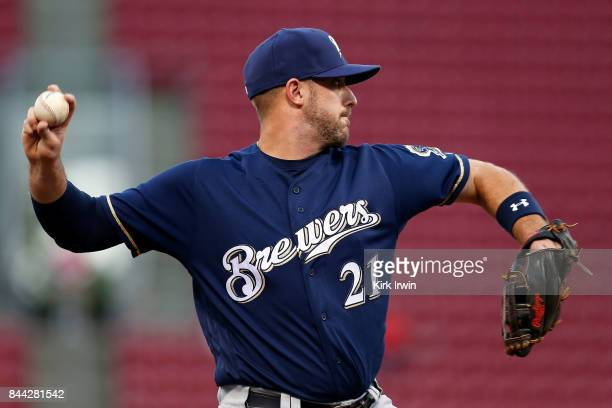 Travis Shaw of the Milwaukee Brewers throws the ball to first base during the game against the Cincinnati Reds at Great American Ball Park on...