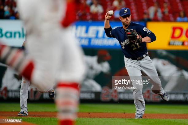 Travis Shaw of the Milwaukee Brewers throws to first base for an out against the St. Louis Cardinals in the third inning at Busch Stadium on April...