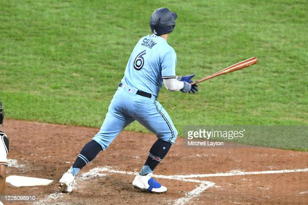 Travis Shaw of the Toronto Blue Jays hits a three run home run in the fifth inning during a baseball game against the Baltimore Orioles at Oriole...