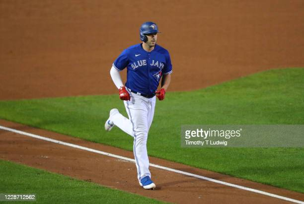 Travis Shaw of the Toronto Blue Jays runs the bases after hitting a home run during the fourth inning against the Baltimore Orioles at Sahlen Field...