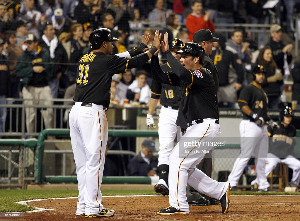 Travis Snider #23 and Jose Tabata #31 of the Pittsburgh Pirates celebrate after scoring on a two RBI single in the fifth inning against the Atlanta Braves during the game on April 19, 2013 at PNC Park in Pittsburgh, Pennsylvania.