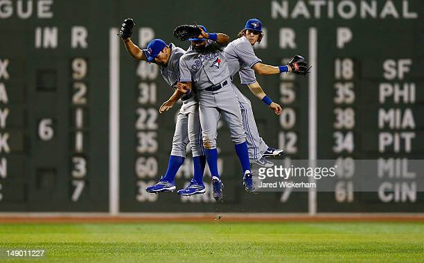 Travis Snider, Anthony Gose, and Colby Rasmus of the Toronto Blue Jays celebrate in center field following their win against the Boston Red Sox...