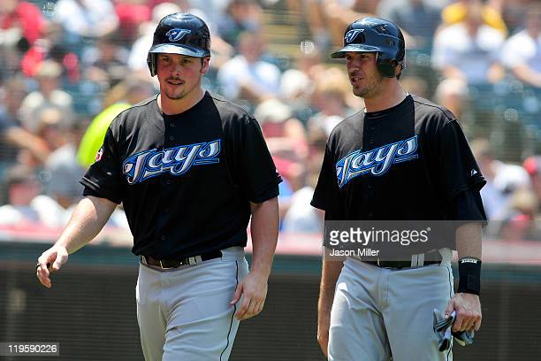 Travis Snider celebrates with J.P. Arencibia of the Toronto Blue Jays after scoring during the third inning against the Cleveland Indians at...