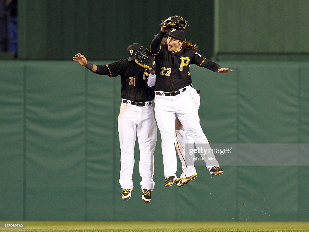 Travis Snider #23, Jose Tabata #31 and Andrew McCutchen #22 of the Pittsburgh Pirates celebrate after winning against the Atlanta Braves during the game on April 19, 2013 at PNC Park in Pittsburgh, Pennsylvania. The Pirates defeated the Braves 6-0.