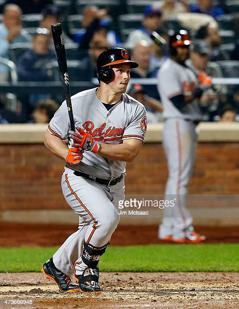 Travis Snider of the Baltimore Orioles follows through on a fifth inning base hit against the New York Mets at Citi Field on May 6, 2015 in the...