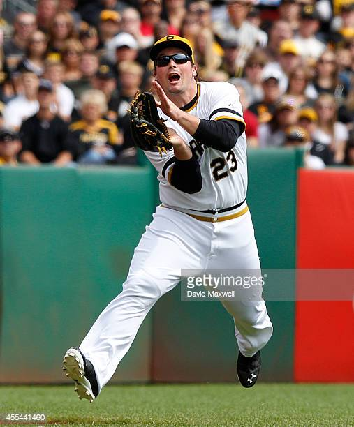 Travis Snider of the Pittsburgh Pirates catches a ball hit by Chris Coghlan of the Chicago Cubs during the first inning of their game on September...