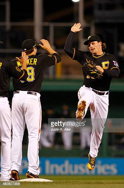 Travis Snider of the Pittsburgh Pirates celebrates after defeating the St. Louis Cardinals 12-2 at PNC Park April 4, 2014 in Pittsburgh, Pennsylvania.