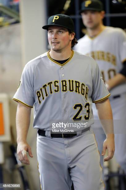 Travis Snider of the Pittsburgh Pirates gets ready in the dugout before the game against the Milwaukee Brewers at Miller Park on April 12, 2014 in...