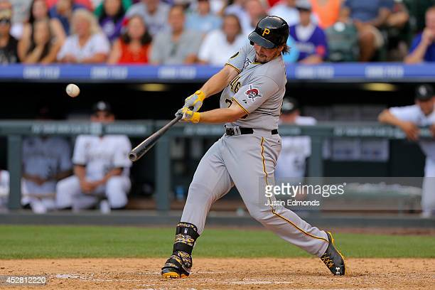 Travis Snider of the Pittsburgh Pirates hits a pinch hit two run home run during the sixth inning against the Colorado Rockies at Coors Field on July...
