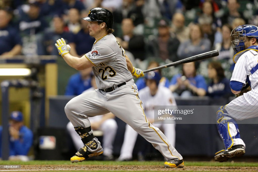 Travis Snider #23 of the Pittsburgh Pirates hits a single advancing Starling Marte to third base in the top of the eighth inning against the Milwaukee Brewers at Miller Park on April 12, 2014 in Milwaukee, Wisconsin.