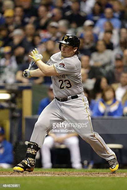 Travis Snider of the Pittsburgh Pirates makes some contact at the plate during the game against the Milwaukee Brewers at Miller Park on April 12,...