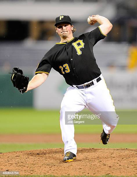 Travis Snider of the Pittsburgh Pirates pitches during the ninth inning against the Cincinnati Reds on June 18, 2014 at PNC Park in Pittsburgh,...