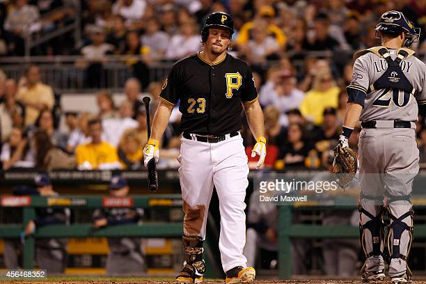Travis Snider of the Pittsburgh Pirates reacts after striking out against the Milwaukee Brewers during the fifth inning of their game on September...