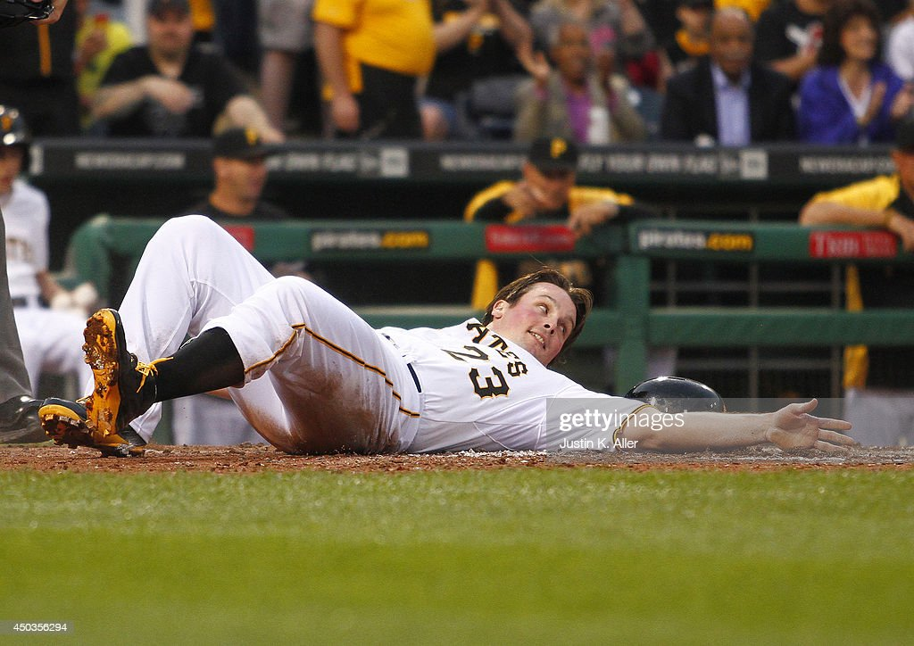Travis Snider #23 of the Pittsburgh Pirates scores on a RBI double in the fifth inning against the Chicago Cubs during the game at PNC Park on June 9, 2014 in Pittsburgh, Pennsylvania.