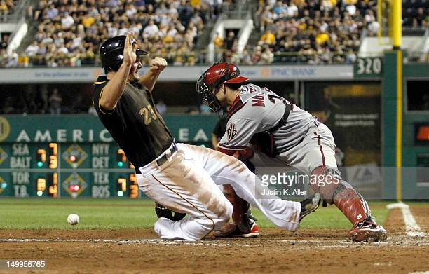 Travis Snider of the Pittsburgh Pirates scores on a sacrifice fly by Neil Walker against the Arizona Diamondbacks during the game on August 7, 2012...