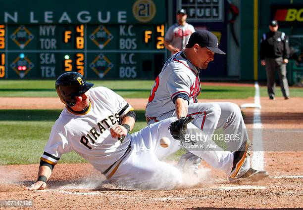 Travis Snider of the Pittsburgh Pirates scores on a wild pitch in the seventh inning by Luis Avilan of the Atlanta Braves during the game on April...