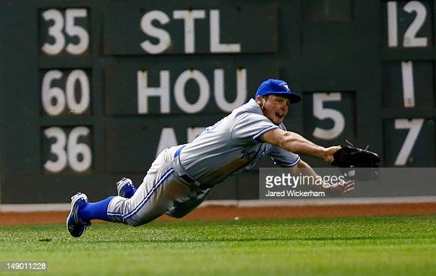 Travis Snider of the Toronto Blue Jays makes a diving catch in left field against the Boston Red Sox during the game on July 21, 2012 at Fenway Park...