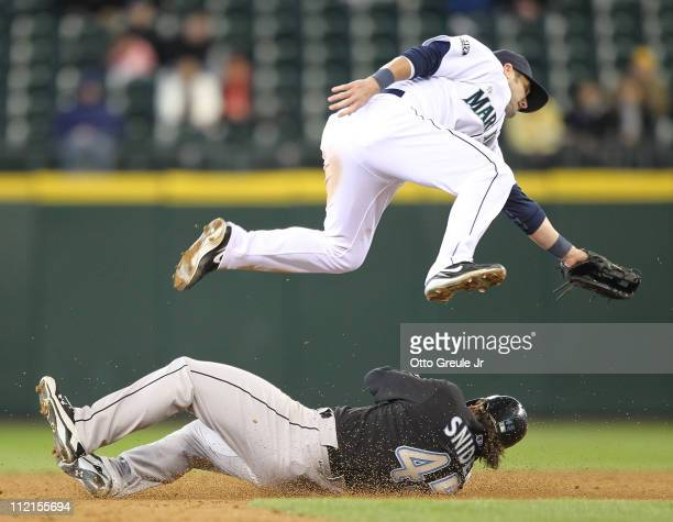 Travis Snider of the Toronto Blue Jays steals second base against Adam Kennedy of the Seattle Mariners at Safeco Field on April 13, 2011 in Seattle,...