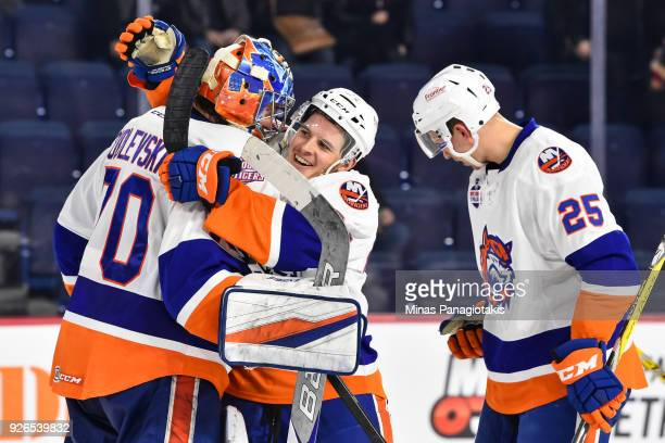 Travis St Denis of the Bridgeport Sound Tigers celebrates a victory with goaltender Kristers Gudlevskis against the Laval Rocket during the AHL game...