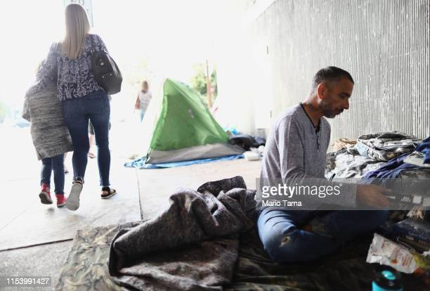 Travis Stanley who said he has been homeless for three months and is a US Navy veteran sits where he normally sleeps beneath an overpass on June 5...