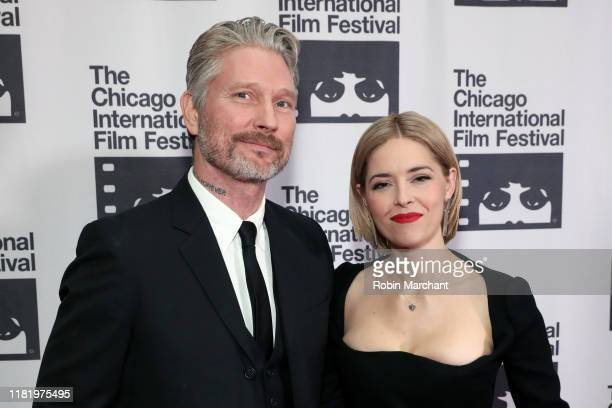 Travis Stevens and Sarah Lind attend the red carpet Premiere of Girl on the Third Floor at the Chicago International Film Festival on October 18 2019...