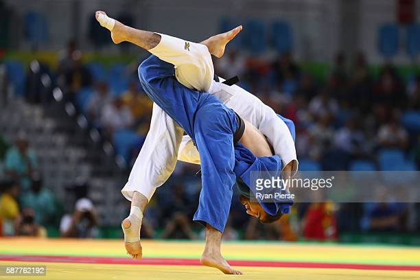Travis Stevens of the United States and Khasan Khalmurzaev of Russia compete in the Men's -81kg gold medal bout on Day 4 of the Rio 2016 Olympic...