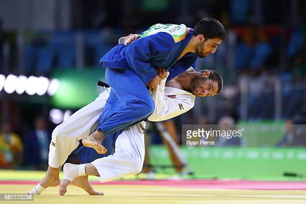 Travis Stevens of the United States and Khasan Khalmurzaev of Russia compete in the Men's 81kg gold medal bout on Day 4 of the Rio 2016 Olympic Games...