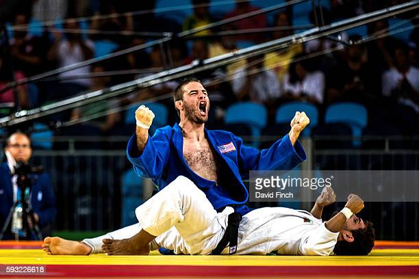 Travis Stevens of the United States held Ivaylo Ivanov of Bulgaria for an ippon to win their u81kg quarter-final contest during day 4 of the 2016 Rio...