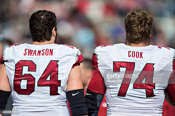 Travis Swanson and Brey Cook of the Arkansas Razorbacks on the sidelines during a game against the Ole Miss Rebels at Vaught-Hemingway Stadium on...