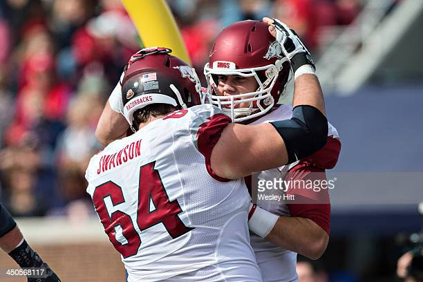 Travis Swanson congratulates Hunter Henry of the Arkansas Razorbacks after a touchdown against the Ole Miss Rebels at Vaught-Hemingway Stadium on...