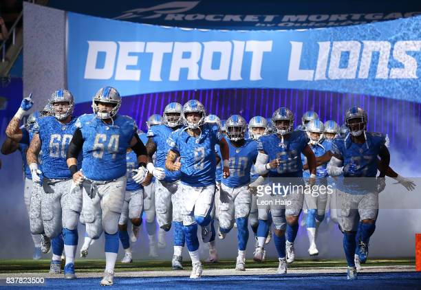 Travis Swanson of the Detroit Lions leads the team onto the field prior to the start of the preseason game against the New York Jets on August 19,...