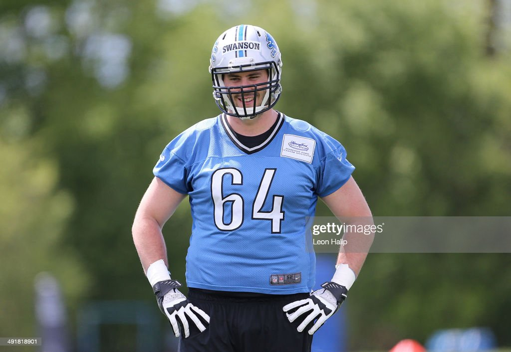 Travis Swanson #64 of the Detroit Lions watches the drills during the Rookie Minicamp on May 17, 2014 in Allen Park, Michigan.