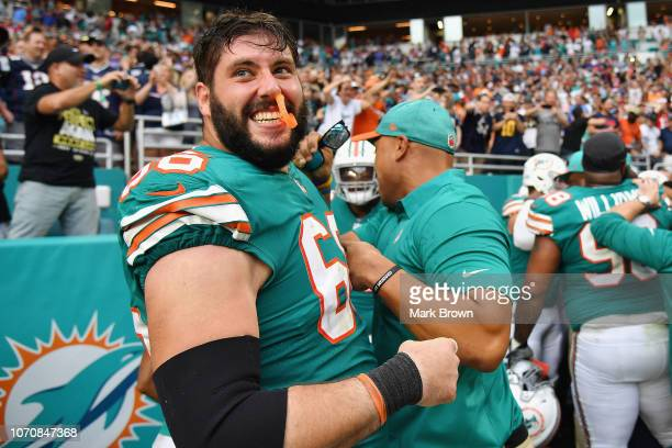 Travis Swanson of the Miami Dolphins celebrates after defeating the New England Patriots 3433 at Hard Rock Stadium on December 9 2018 in Miami Florida