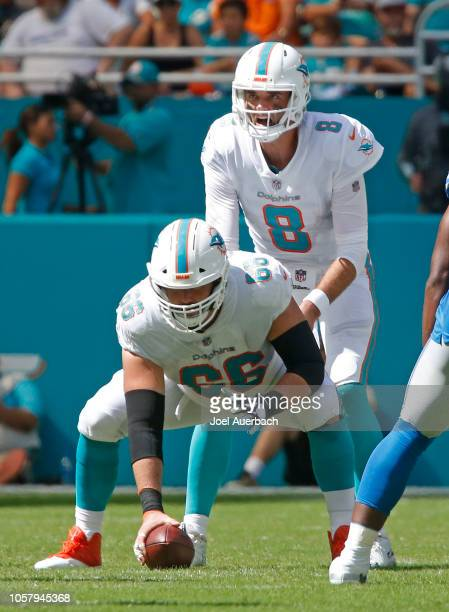 OCtOBER 21: Travis Swanson prepares to snap the ball to Brock Osweiler of the Miami Dolphins against the Detroit Lions during an NFL game on October...